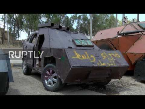 Thumbnail: Iraq: Vehicles seized from Islamic State car bomb factory go on display