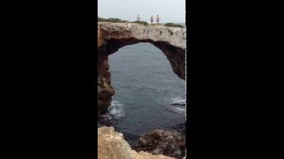 Cliff jumping from arch in Cala Varques Mallorca