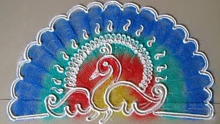 Peacock rangoli using paper quilling comb | Innovative rangoli designs by Poonam Borkar