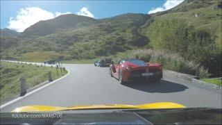 McLaren P1 chases a Ferrari LaFerrari on Furkapass Switzerland