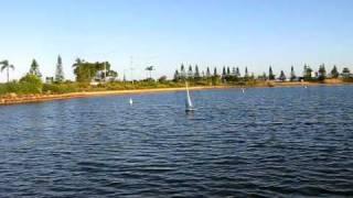 rc Hurricane yacht sailing by LR. sunshine coast. Qld