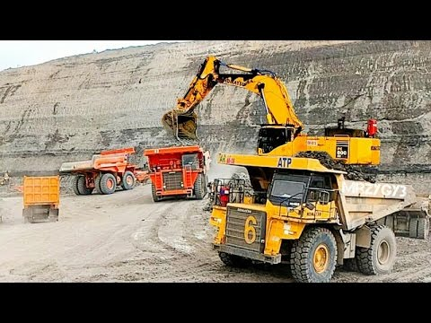 Large Excavator And Dump Truck Working In Coal Mine