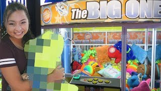 Winning BIG prizes from the giant claw machine!
