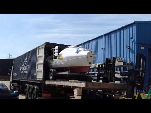 Ocean rowing boat 'Alliance Trust' being loaded into shipping container