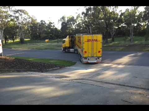 Backing up Scania R580 at work reversing semi trailer on blind side