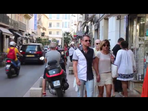 A morning on Rue D'Antibes, Cannes: Ladies in flowy dresses, mini skirts and shorts.