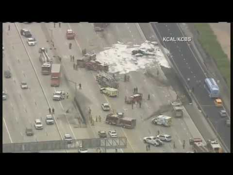 Fiery plane crash jams L.A. freeway, 2 injured