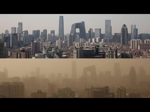 Dust storm  in Beijing , China , air pollution, smog and sand storm, people choke,