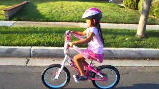 Adrienne Morrow rides her bicycle without training wheels or help!