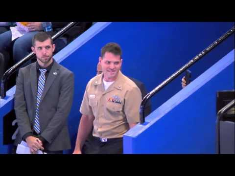 Father surprised by return of Naval officer son at Tampa Bay Lightning game