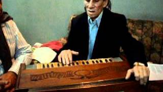 Master Manju plays the Harmonium