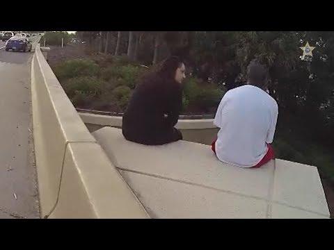 Woman uses Linkin Park lyrics to comfort man on overpass ledge