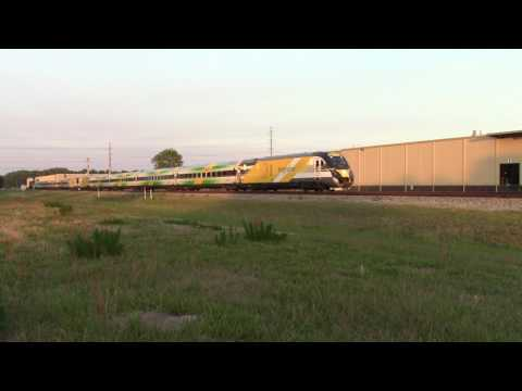 W999 green and orange Brightline trains through Whitehouse, Fl