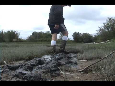 rubber boots in the swamp.wmv