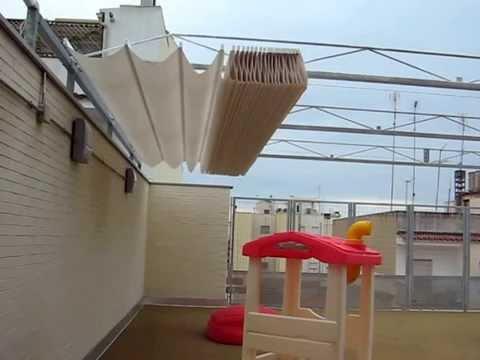 Colocaci n de un toldo de vela doovi for Toldos corredizos para terrazas