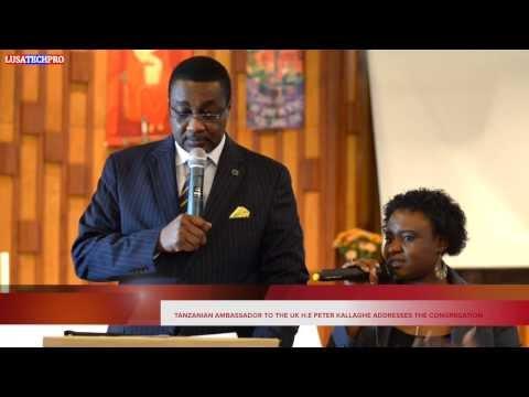 HE. TANZANIAN AMBASSADOR TO THE UK ADDRESSES THE CONGREGATION.