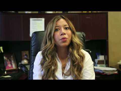 Michelle Vidal explaining the extra money program