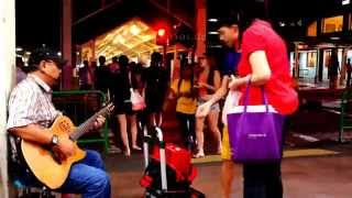 Blind Singer singing American Folk Song in Singapore of Asia
