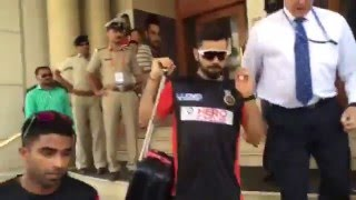 Virat Kohli comes out to get into the bus and the crowd chants Kohli! Kohli!