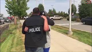 First responder comforts community member at Freeman High School