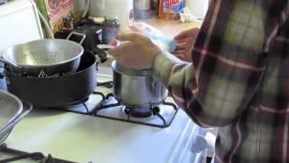 Ryan prepares himself a bowl of Top Ramen.