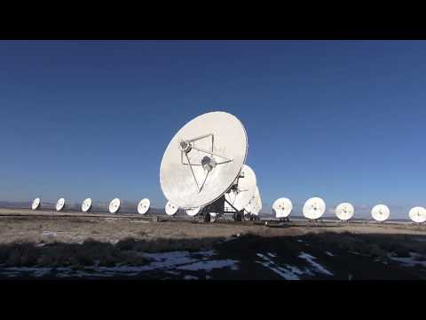 Very large array radio telescopes moving into different positions. Magdalena, NM.