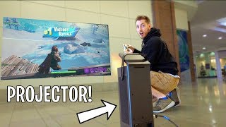 PLAYING FORTNITE ON PROJECTOR IN STORES!
