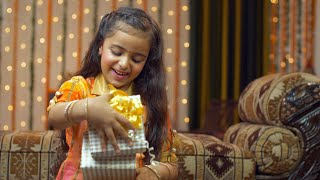 Young girl with a present in traditional wear on Raksha Bandhan / Bhai Dooj  - festive season