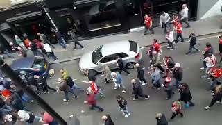 FC KOLN FANS MARCHING THROUGH SOHO. ARSENAL.