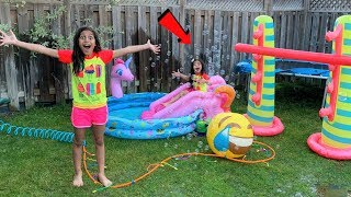 Deema Play with Inflatable water Toys in our backyard