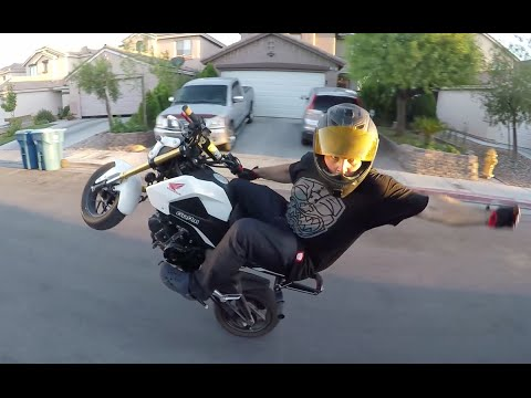 a grom, mini motot world...squad, aka honda msx125, z 125, scooter, real one and only motorbikes,wheelies, stoppies, balance point & more