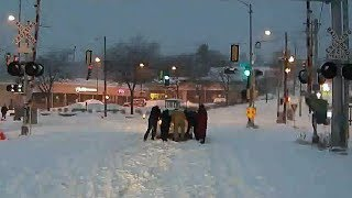 Milwaukee Bus Driver, Riders Team Up to Push Stuck Car Off Railroad Tracks