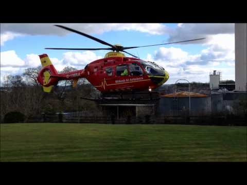 Midlands Air Ambulance G-HWAA Taking Off From Derriford Hospital Plymouth Devon