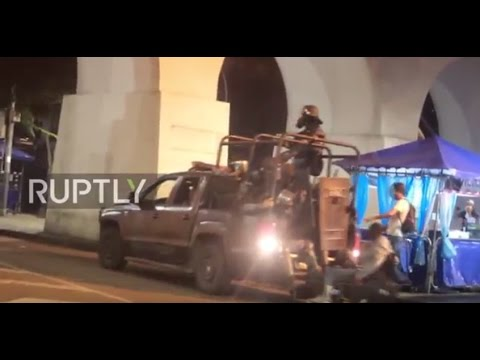 Brazil: Riot police vehicle knocks over man in wheelchair amid clashes in Rio
