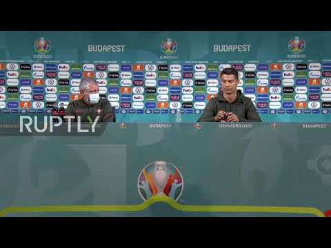 """Hungary: """"Drink water"""" - Ronaldo removes Euro 2020 sponsor Coca-Cola bottles during press conference"""