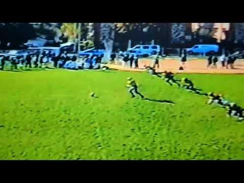 Cal park Rams 1999 Freddie Barnes kicks off.