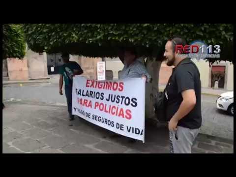 VIDEO Policías se manifiestan para exigir pagos de compensaciones