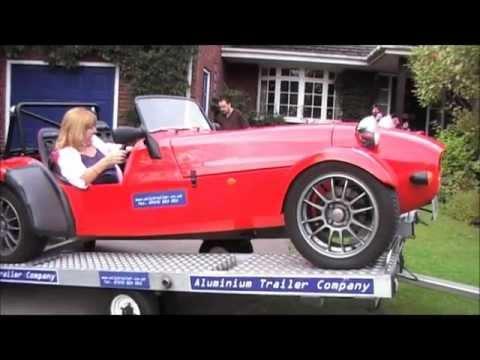 lightweight tilt bed car trailer that becomes a working platform