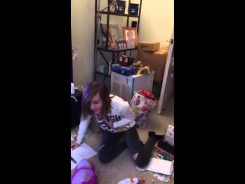 Daughters reaction to getting 5 Seconds of Summer tickets.