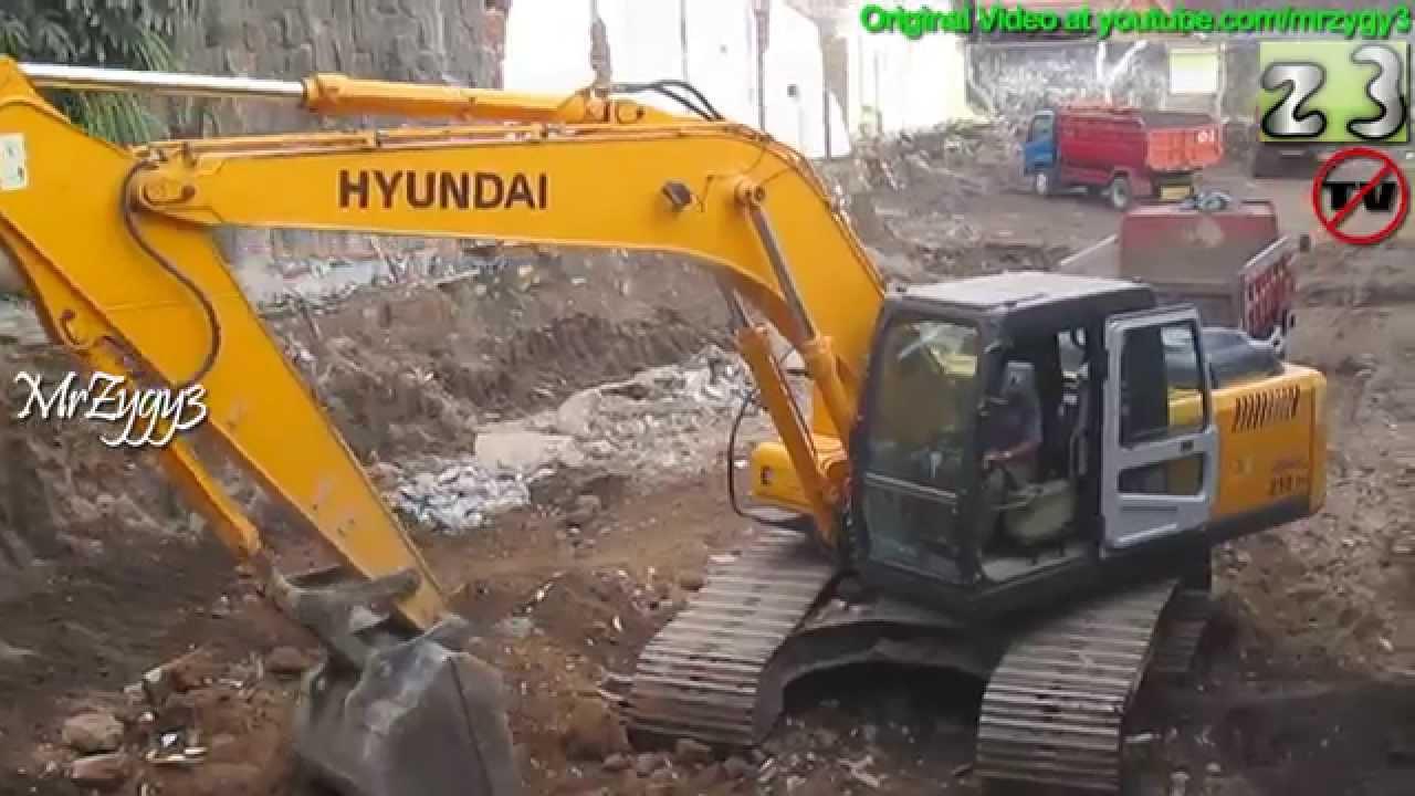 Excavator Hyundai 210 Robex Loading Debris Toyota Dyna Dumper