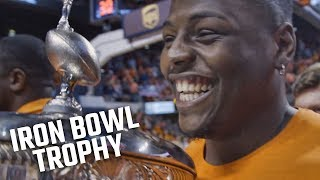 Auburn accepts Iron Bowl trophy from Alabama
