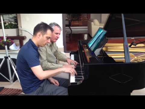 German and Luxembourg Ambassadors in Kosovo playing piano