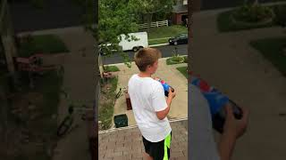 Throwing 2 liter soda bottles off roof