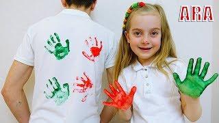 يتمتع Ulya و Dad بلوحة ممتعة مع طلاء ملون على قميص