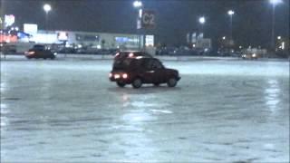 5 mins of cars sliding on the snow / ice + little crash