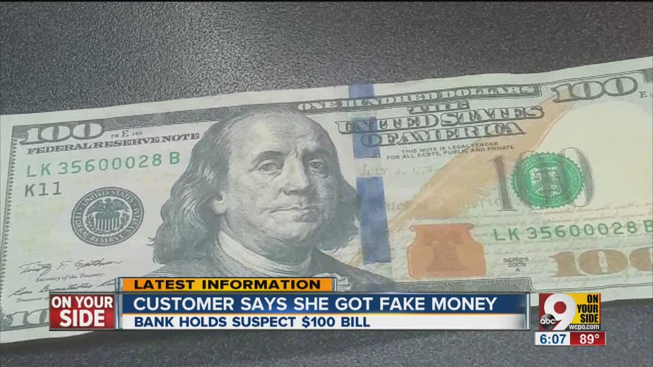 Real or counterfeit? Bank refuses to accept $100 bill from credit union - YouTube