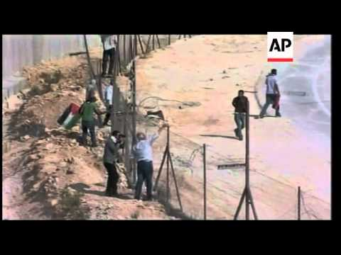 Middle East - Protesters cut through West Bank separation barrier / Protesters clash with Israeli tr