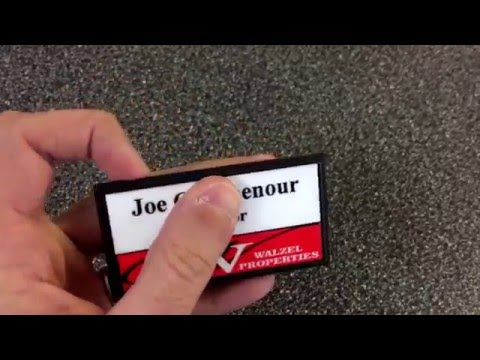 """Review of 3x1-1/2"""" metal name tag with black plastic holder."""