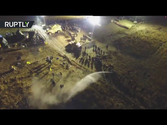 Drone dodges water cannon to capture DAPL protest