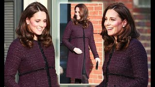 Kate Middleton's bump looks bigger than ever in a stunning festive coat
